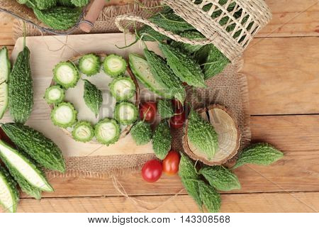 Bitter melon and sliced on wood background