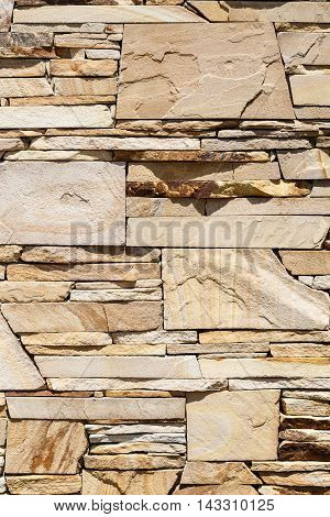 The texture of the exterior cladding sandstone wall Brown