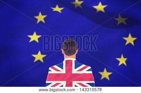 Businessman looking in front of him in suit against digitally generated uk national flag