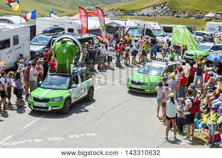 Col du Glandon France - July 23 2015: Skoda caravan during the passing of the Publicity Caravan on Col du Glandon in Alps during the stage 18 of Le Tour de France 2015. Skoda is the official car of the competition and sponsors the Green Jersey.