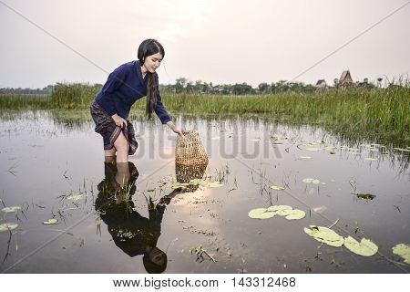 Happy working woman in countryside Thailand, Asia