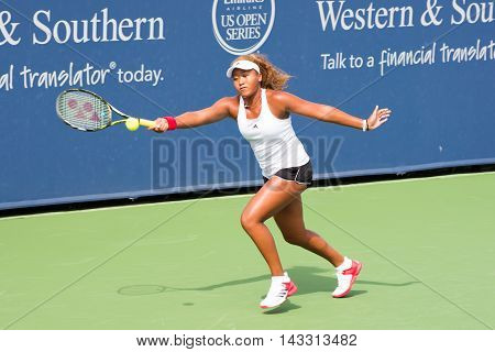 Mason Ohio - August 14 2016: Naomi Osaka in a qualifying match at the Western and Southern Open in Mason Ohio on August 14 2016.