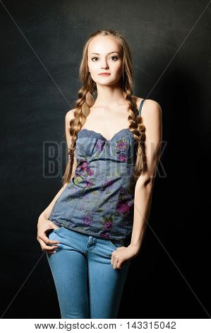 Fashion beautiful Girl with light hair on Dark Background