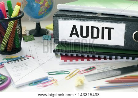 Audit note with file on office desk
