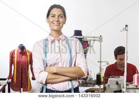 Confident Tailor Standing Arms Crossed In Factory