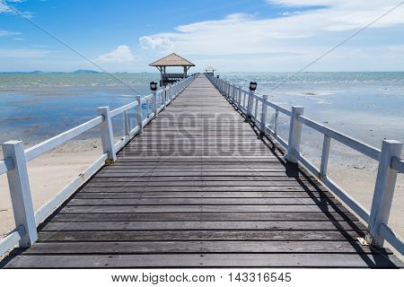 The wooden bridge walkway jutting into the sea.