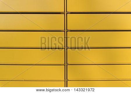 Metal horizontal blinds, texture yellow metal blinds