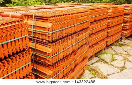 Stacks Of Red Tiles Associated With Warehousing And Transportation, To Build A House. The Roof Of A