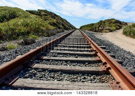 Old Railroad Track Under Blue Sky