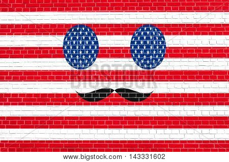 Funny face made of USA flag simbols with mustaches on brick wall texture background. Face painted in style of the American flag. Patriotic design in the United States of America flag colors.
