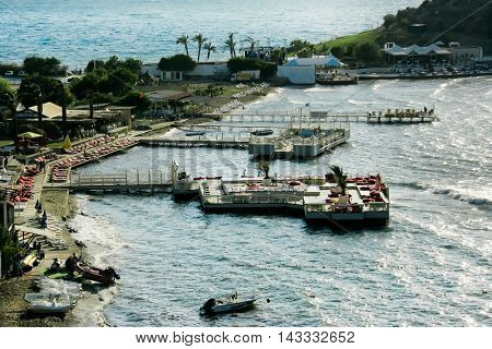 KUSADASI, Turkey - MAY 20, 2016: Elevated view of docks on beach of Kusadasi. Editorial image
