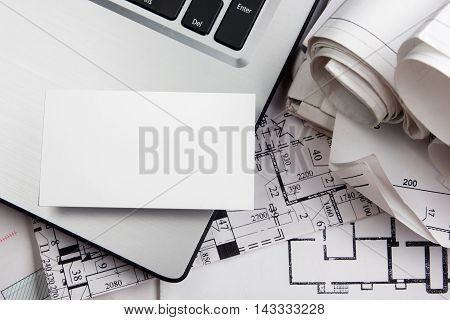 Blank business card with house figure. Real Estate Concept. Top view