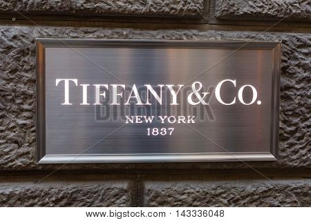 Florence Italy - July 05 2016: emblem with the logo of Tiffany and Co. Tiffany and Company is an American luxury jewelry and specialty retailer headquartered in New York City
