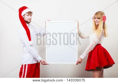 Couple Woman And Man With Blank Banner. Copy Space
