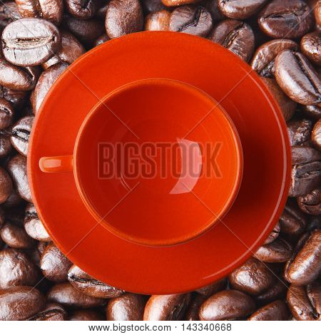 Orange Cup On The Coffee Beans. Close Up