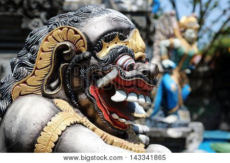 Side view of the face of a Balinese monster guarding an entrance in Bali Indonesia