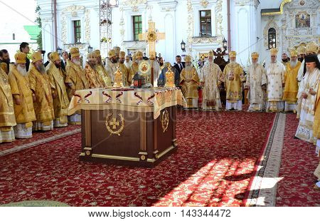Kiev Ukraine celebration liturgy in honor of the baptism of Rus in Kiev Pechersk Lavra - 27 July 2013 -: Many of the Patriarchs and Metropolitan standing around the throne at the celebratory liturgy outdoors