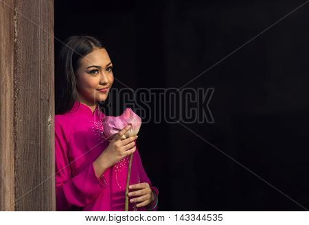 Portrait of Vietnamese girl traditional dress with lotus