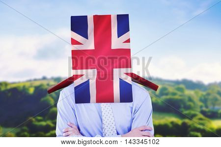 Anonymous businessman against digitally generated uk national flag