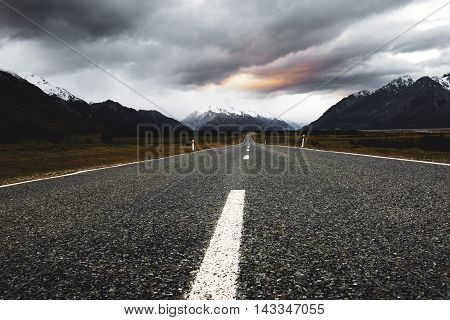 A low angle shot at the middle of an empty road.