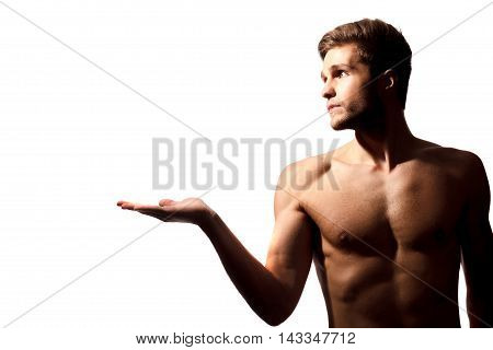 Profile of perfect male form. Shot of handsome young shirtless man showing to copyspace isolated on white background