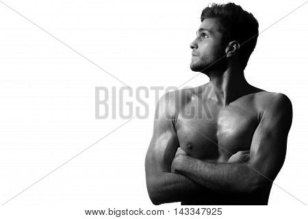 Showing off his muscular perfection. Studio shot of muscular man with his arms crossed isolated on white background