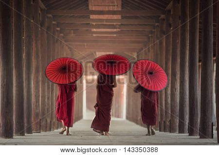 Buddhist novice are walking in temple Myanmar