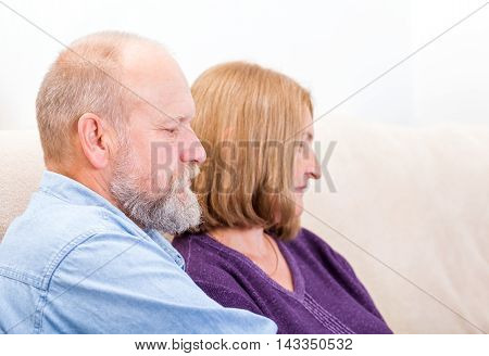 Close up photo of unhappy middle aged couple
