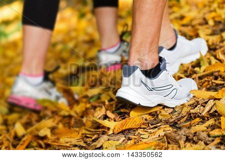 Close up photo of runners shoes and legs in action