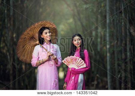 Portrait of Vietnamese girl traditional dress Ao dai is famous traditional costume for woman in Vietnam