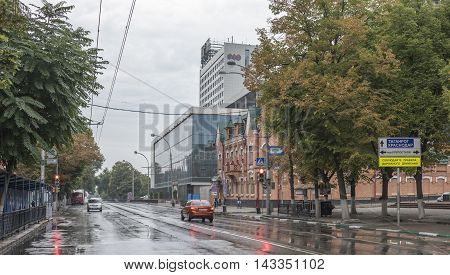 Rostov-on-Don Russia -August 142016: On Bolshaya Sadovaya after the rain moving cars and citizens on bicycles