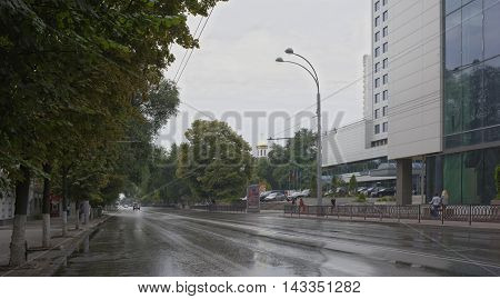 Rostov-on-Don Russia -August 142016: On Bolshaya Sadovaya after the rain moving cars and citizens
