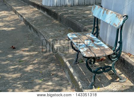Old Rusty Decorative Blue Wooden Park Bench Standing in The Park.