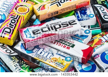 Moscow, RUSSIA - May 24, 2016: various brand chewing gum. chewing gum brands Orbit, Dirol, Eclipse, Stimorol, Wrigley's, Spearmint. a lot of chewing gum packages. focus on chewing gum Eclipse