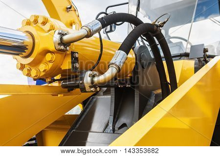 hydraulics tractor yellow. focus on the hydraulic pipes
