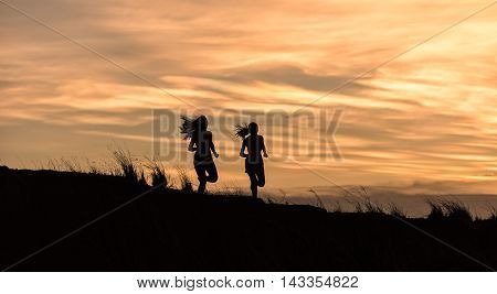 Young fitness woman running on sunrise, Thailand
