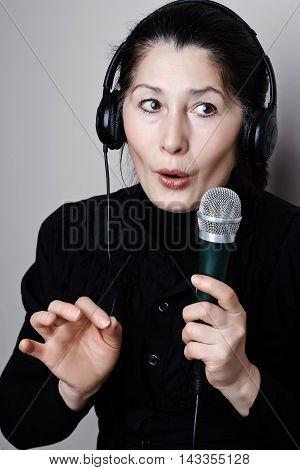 Beautiful mature asian woman  listening to music through headphones
