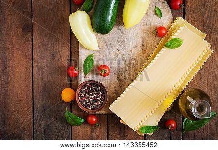 Ingredients For Vegetarian Lasagna On A Wooden Background. Dietary Menu. Top View