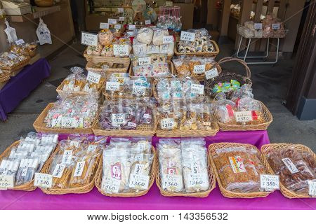 TOKYO JAPAN - 20 JULY 2016 - Seafood snacks and other japanese style snacks are for sale at a shop in Tsukiji Fish Market in Tokyo Japan on July 20 2016