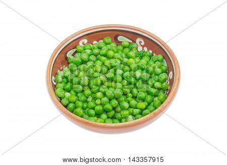 Blanched green peas in ceramic bowl on a light background