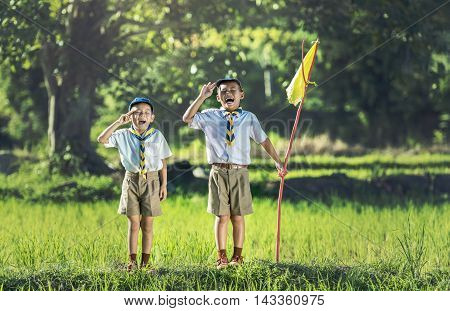 Boy scout making an oath, countryside of Thailand