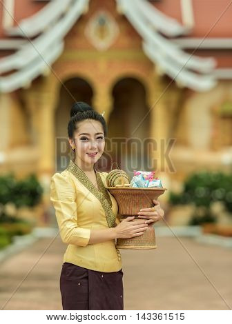 Young woman off smile of silk dress asian woman in silk dress in temple