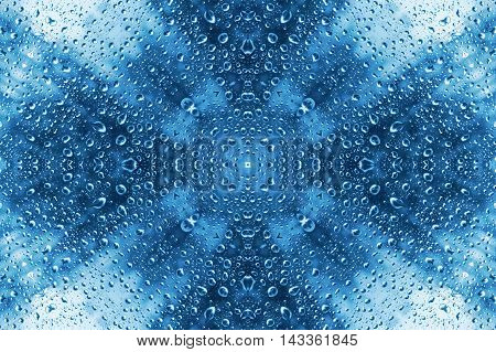 Blue abstract pattern of water drops on glass