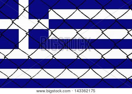 Greek flag, cracks and fence - Refugee crisis concept