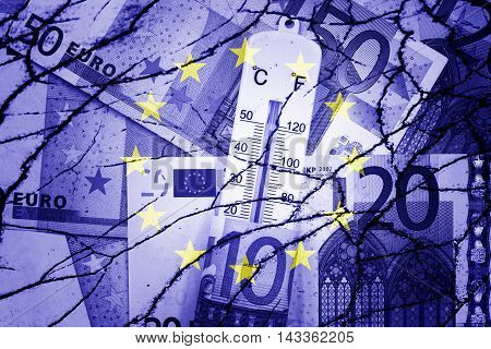 Thermometer, euros, EU flag and cracks - Finance/Business concept