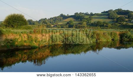 Bank of the River Axe in East Devon England