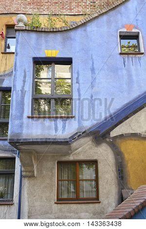 Vienna, Austria - August 15, 2016: Details Of The Hundertwasserhaus Facade, An Apartment Building Bu