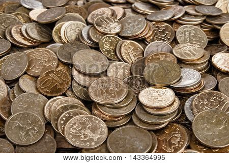 Heap of the coins on wooden background. Stock image macro.