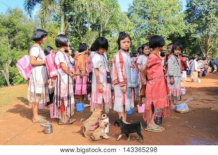 Tak Thailand-Jan 16: Karen children stand in line at border primary school on Jan 16 2015 in Tha Song Yang Tak Thailand. School located in mountain near Thailand-Myanmar border for help and study Ethnics children