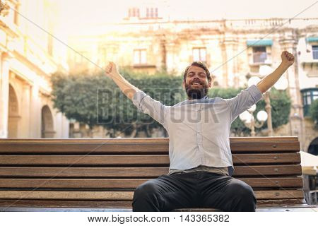 Relaxed man sitting on a bench